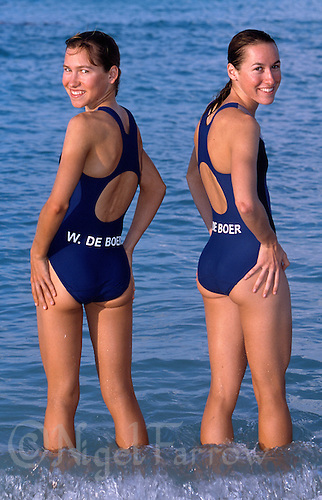 10 NOV 2002 - CANCUN, MEX - Triathletes, and sisters, Wendy de Boer and Tanya de Boer relax at the beach (PHOTO (C) NIGEL FARROW)
