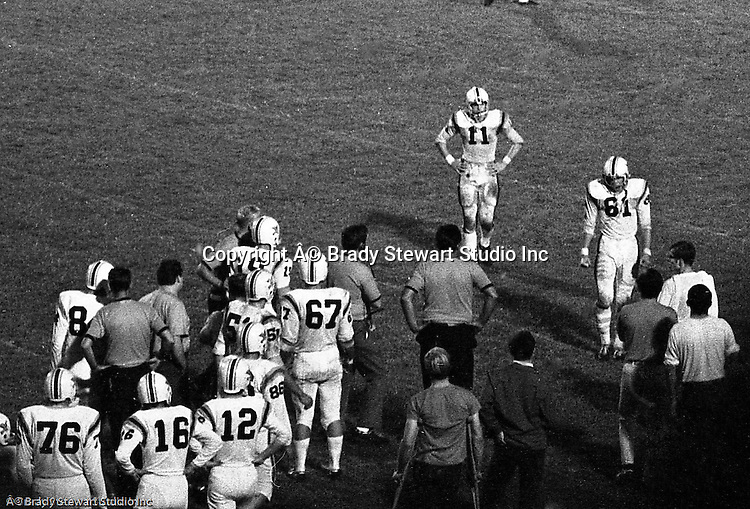 Bethel Park PA:   Mike Stewart 11 and Gary Biro walking over to the sidelines after Gary Biro was ejected from the game.  Others in the photo; Coach Andabaker, Coach Mongelluzzo, Don Troup 51, Dunkerley 16, Gary Biro 81, Jim Beck 67, John Bender 19, Mike Laboon, Mike Stewart 11, Puglisi 76, Tom Skladany 86. The offense and defense did not play well in the 12-6 defeat vs Montour. Montour's quarterback, Jim Daniels, killed the Blackhawks.  Jim Daniels was played his college ball at Pitt.  The defensive unit was one of the best in Bethel Park history only allowing a little over 7 points a game.