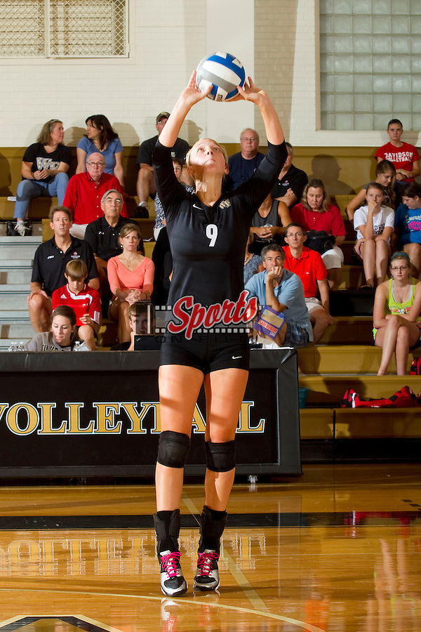 Danae Rosendall (9) of the Wake Forest Demon Deacons sets the ball during the match against the Davidson Wildcats in Reynolds Gymnasium on September 1, 2012 in Wake Forest, North Carolina.  The Demon Deacons defeated the Wildcats 3-2.   (Brian Westerholt / Sports On Film)