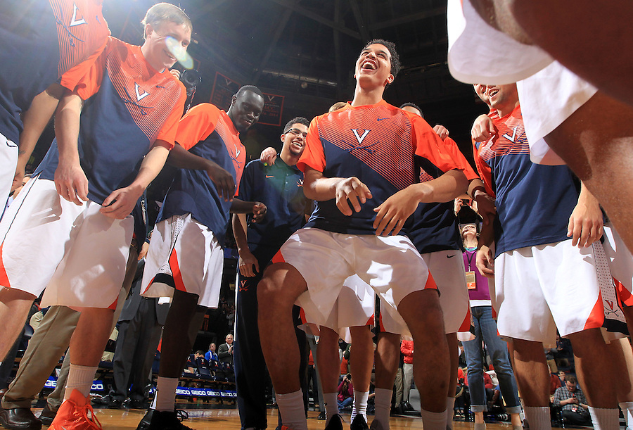 Virginia players in the huddle before the start of the NC State game Wednesday Jan. 7, 2015 in Charlottesville, Va.