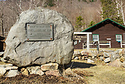 The landslide of 1826 plaque at the site of the Willey House in Crawford Notch State Park of the White Mountains, New Hampshire. This massive landslide came down Mount Willey on August 28, 1826. And boulders located just above the house caused the landslide to split into two debris flows around the house. The house was said to be untouched, but all seven members of the family and two hired men perished in the slide while trying to escape to a safe area.