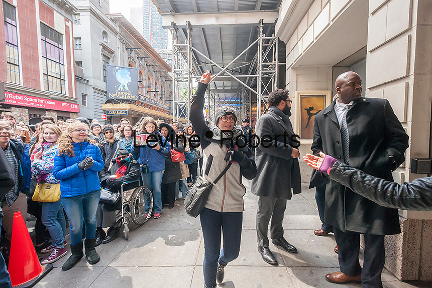 "A winner comes forward at the Richard Rodgers Theatre in Times Square in New York on Wednesday, April 6, 2016 after her name is called for tickets in the #Ham4Ham lottery for seats for the Broadway blockbuster ""Hamilton"". The $10 live lottery takes place in front of the theater for the Wednesday matinee performance while for the rest of the week's performances the lottery is online. (© Richard B. Levine)"
