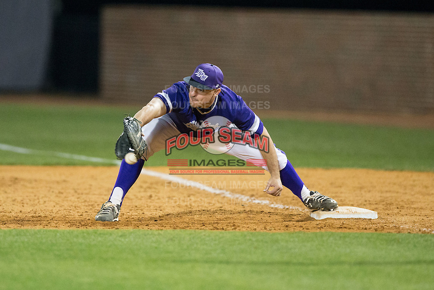 High Point Panthers first baseman Zack Gray (32) stretches for a throw during game two of a double-header against the NJIT Highlanders at Williard Stadium on February 18, 2017 in High Point, North Carolina.  The Highlanders defeated the Panthers 4-2.  (Brian Westerholt/Four Seam Images)