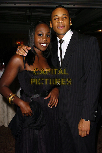 PETRA LETANG & REGGIE YATES.Gift Of Life VII Charity Dinner, Royal Lancaster Hotel, London, England, September 16th 2006..half length black dress.Ref: CAN.www.capitalpictures.com.sales@capitalpictures.com.©Can Nguyen/Capital Pictures