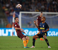Calcio, Serie A: Roma vs Inter. Roma, stadio Olimpico, 2 ottobre 2016.<br /> Roma&rsquo;s Alessandro Florenzi, left, and FC Inter&rsquo;s Joao Mario fight for the ball during the Italian Serie A football match between Roma and FC Inter at Rome's Olympic stadium, 2 October 2016.<br /> UPDATE IMAGES PRESS/Isabella Bonotto