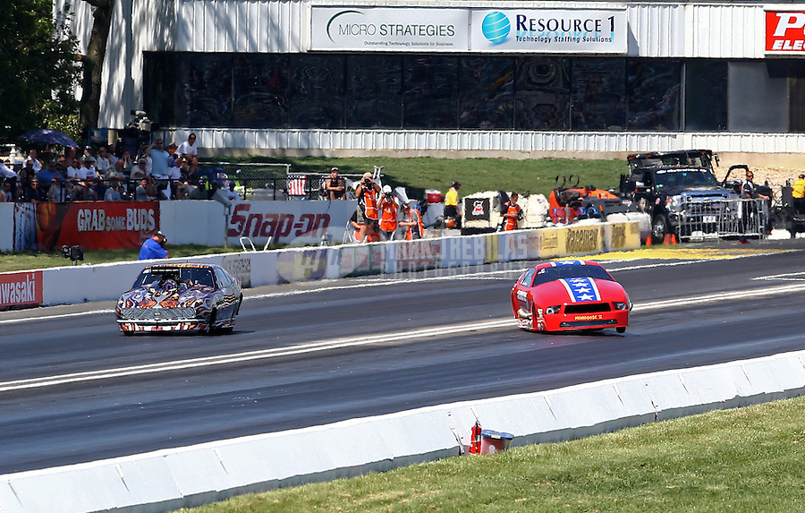 Jun. 1, 2013; Englishtown, NJ, USA: NHRA pro mod driver Steve Matusek (right) gets sideways alongside Mike Knowles during qualifying for the Summer Nationals at Raceway Park. Mandatory Credit: Mark J. Rebilas-