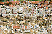 Orford, Suffolk. Wall of mixed brick, flint, stone and pebbles.