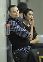 Saints owner Nick Mills watches the match with communications manager Tara Hakawai during the national basketball league match between Wellington Saints and Manawatu Jets at TSB Bank Arena, Wellington, New Zealand on Tuesday, 7 May 2013. Photo: Dave Lintott / lintottphoto.co.nz