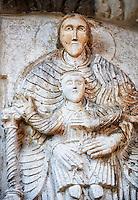 Lunette of the main portal with Romanesque sculptures of the Modona and child , Basilica Church of Santa Maria Maggiore, Tuscania