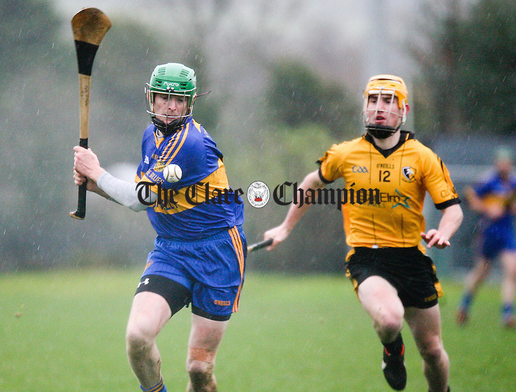 Newmarkets Martin O'Hanlon under pressure from Clonlaras Colm Galvin during their Clare Champion Cup Final at Sixmilebridge on Sunday.