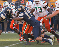 Pitt defensive lineman Rashad Weaver (17) sacks Miami quarterback Malik Rosier. The Pitt Panthers upset the undefeated Miami Hurricanes 24-14 on November 24, 2017 at Heinz Field, Pittsburgh, Pennsylvania.