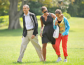 Washington, D.C. - September 6, 2009 -- United States President Barack Obama and his family return to the White House aboard Marine 1 after spending the past few days as Camp David on Sunday, September 6, 2009. From left to right: President Obama, first lady Michelle Obama, and Malia Obama..Credit: Ron Sachs / Pool via CNP