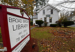 The  Broad Brook Library, a tiny, one-room library located on Main Street in Broad Brook, on one of the two days a week the library is open, Wednesday, November 22, in East Windsor.  (Jim Michaud / Journal Inquirer)