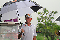 Marcel Siem (GER) arrives back at the clubhouse as the heavens open yet again as monsoon rains fall during Saturday's storm delayed  Round 3 of the Iskandar Johor Open 2011 at the Horizon Hills Golf Resort Johor, Malaysia, 19th November 2011 (Photo Eoin Clarke/www.golffile.ie)
