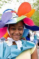 Happy African American woman age 17 costumed for the parade. MayDay Parade and Festival. Minneapolis Minnesota USA