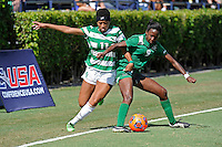 8 November 2015:  North Texas Forward Marchelle Davis (11) battles Marshall Forward Sydney Arnold (9) for the ball in the second half as the University of North Texas Mean Green defeated the Marshall University Thundering Herd, 1-0, in the Conference USA championship game at University Park Stadium in Miami, Florida.