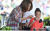 Comedian Skai Jackson from the comedy series Jessie makes a fruit salad with First Lady Michelle Obama during the annual White House Easter Egg Roll on the South Lawn of the White House April 21, 2014 in Washington, DC. President Barack Obama and first lady Michelle Obama hosted thousands of people during the annual celebration of Easter. <br /> Credit: Olivier Douliery / Pool via CNP