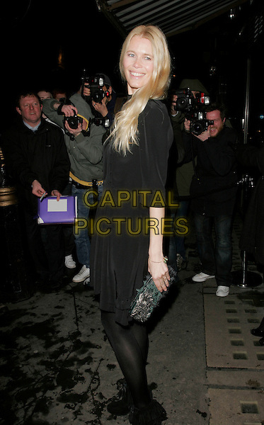 CLAUDIA SCHIFFER.At the Celebration Of Film Dinner, Ceccioni's, London, England, February 6th 2009..full length black dress clutch bag tights  shoes booties ankle boots sleeves bows tied laces .CAP/AH.©Adam Houghton/Capital Pictures