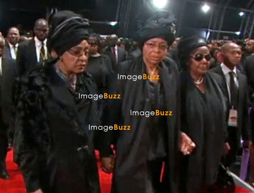 Qunu, South Africa: 15.12.2013: STATE FUNERAL FOR NELSON MANDELA<br /> GRACA MACHEL AND WINNIE MANDELA<br /> attend the Funeral Service for former President Nelson Mandela in Qunu, Eastern Cape, South Africa