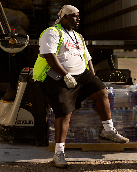 August 6, 2016. Flint, Michigan.<br />  Charles Brady is a truck river who delivers bottles water to distribution centers around Flint. <br />  Although Flint city government says their water is safe to drink when filtered properly, many residents still rely on bottled water for drinking and bathing. Through federal emergency funds, the state distributes 1000's of cases of bottled water nearly every day to Flint residents. <br />  In April 2014, the city of Flint switched its water source from the Detroit Water and Sewerage Department to using the Flint River in an effort to save money. When the switch occurred, the city failed to have corrosion control treatment in place for the new water. This brought about a leaching of lead from pipes into the water, increasing the lead content in the drinking water to levels far above legal limits. After independent sources brought this to light, the city admitted the water was unsafe and legal battles have ensued between resident and the local and state governments.