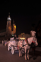 Horse drawn carriages in the city square of Krakow, Poland