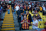 Home fans checking their phones during half-time as Bradford City played Carlisle United in a Skybet League 2 fixture at Valley Parade. The home team were looking to bounce back after being relegated during a disastrous 2018-19 season on and off the pitch. Bradford won the match 3-1, watched by a crowd of 14, 217.