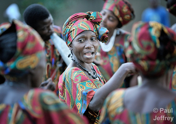 Members of the choir of the United Methodist Church in Kamina, Democratic Republic of the Congo, sing and dance during an outdoor worship celebration.