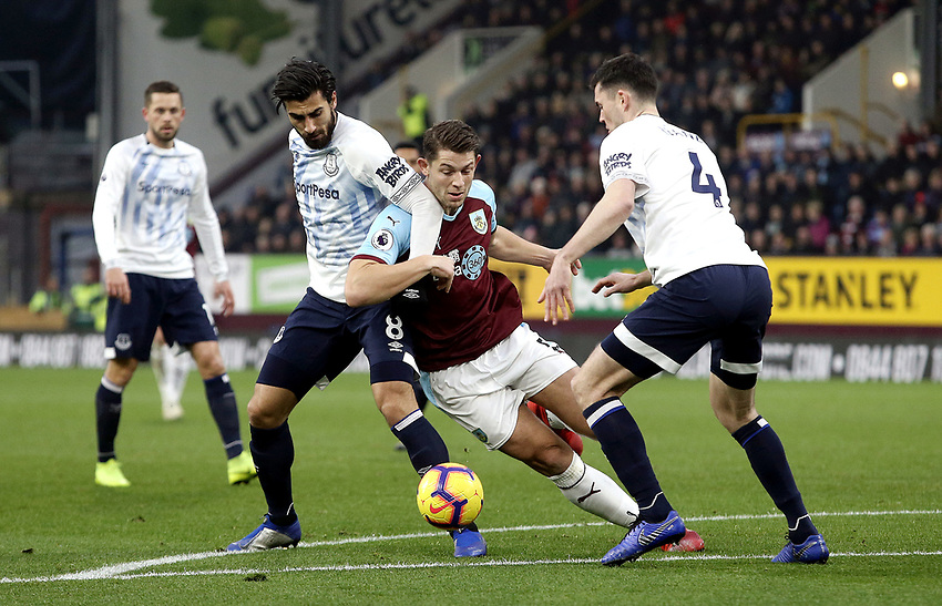 Burnley's James Tarkowski battles with Everton's Andre Gomes (left) and Michael Keane<br /> <br /> Photographer Rich Linley/CameraSport<br /> <br /> The Premier League - Burnley v Everton - Wednesday 26th December 2018 - Turf Moor - Burnley<br /> <br /> World Copyright © 2018 CameraSport. All rights reserved. 43 Linden Ave. Countesthorpe. Leicester. England. LE8 5PG - Tel: +44 (0) 116 277 4147 - admin@camerasport.com - www.camerasport.com