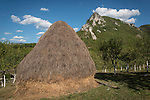 Haystack and peak with cloud at the Monastery Mileševa, Serbia originally built in the 12th century.