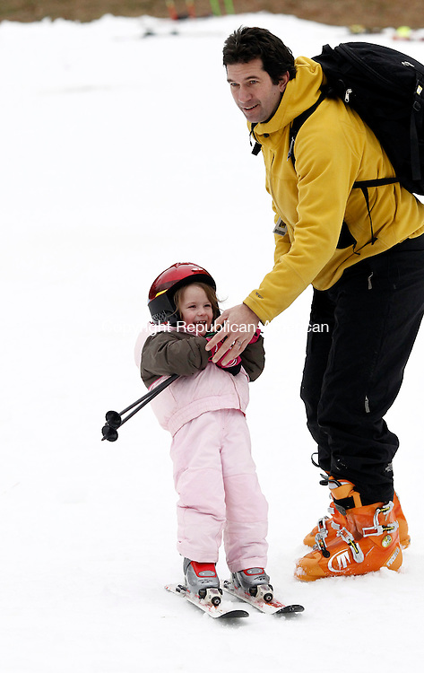 New Hartford, CT- 28 December 2014-122814CM06-  Kirt Mayland, of Avon helps his daughter, Katalina Mayland, 3,  maintain balance at Ski Sundown in New Hartford on Sunday.  Mayland said it was the first time his daughter went skiing. Folks hit the slopes after unseasonable temperatures were seen across the area.  According to the National Weather Service, Monday is expected to be mostly sunny, with a high near 36F.    Christopher Massa Republican-American