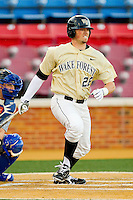 Charlie Morgan #26 of the Wake Forest Demon Deacons follows through on his swing against the UNC-Asheville Bulldogs at Wake Forest Baseball Park on February 28, 2012 in Winston-Salem, North Carolina.  The Demon Deacons defeated the Bulldogs 9-8.  (Brian Westerholt/Four Seam Images)