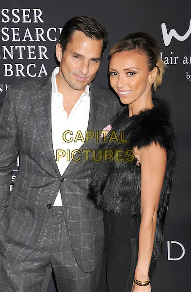 SANTA MONICA, CA- OCTOBER 18: TV personalities Bill Rancic (L) and Giuliana Rancic attend Elyse Walker presents the 10th anniversary Pink Party hosted by Jennifer Garner and Rachel Zoe at HANGAR 8 on October 18, 2014 in Santa Monica, California.<br /> CAP/ROT/TM<br /> &copy;Tony Michaels/Roth Stock/Capital Pictures