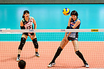 Yuki Ishii of Japan (R) passes the ball during the match between China and Japan on May 30, 2018 in Hong Kong, Hong Kong. (Photo by Power Sport Images/Getty Images)