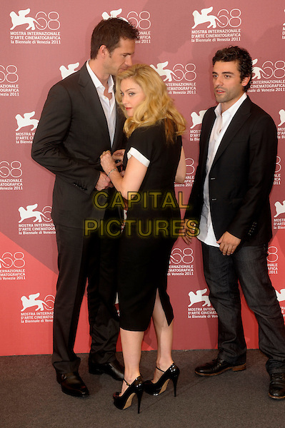 James D'Arcy, Madonna & Oscar Isaac.Attending the 'W.E.' photocall at the Palazzo Del Cinema during the 68th Venice Film Festival in Venice, Italy..September 1st, 2011..full length dress ankle strap platform mary janes shoes peep toe silver cross necklace  black white collar high trim sleeves  fastening doing up button on suit jacket white shirt grey gray side back rear behind .CAP/PL.©Phil Loftus/Capital Pictures.