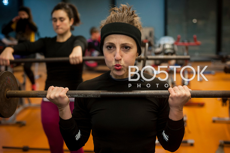 Oihana Cereijo, a female rower on San Juan rower Club on a workout session in the club's gym. Pasaia (Basque Country). January 26, 2017. (Gari Garaialde / BostokPhoto)