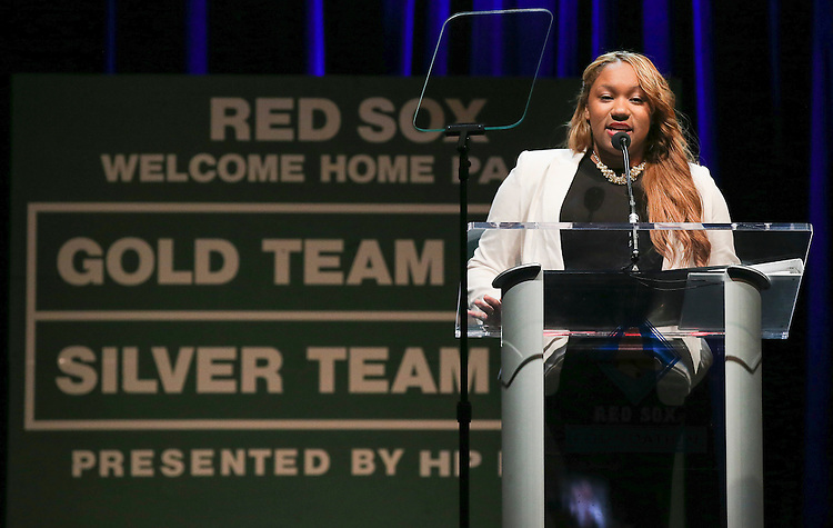 """Lois Gordon, a member of the first class of Red Sox Scholars in 2003 and a senior at Wheaton College, speaks at the Red Sox Foundation's annual """"Welcome Home Party,"""" a fundraiser to benefit the Foundation's programs for the families of New England at the House of Blues in Boston on Friday, April 4, 2014. (Brita Meng Outzen/Boston Red Sox)"""
