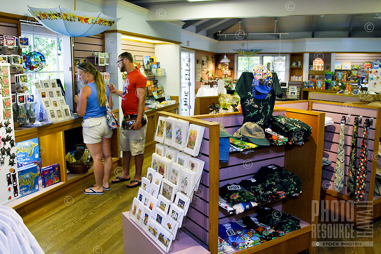 Shoppers stop in the gift shop at the Waimea Valley Audobon Center after a day of exploration and education. Located along the north shore of Oahu.