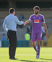 Derek Adams manager of Plymouth Argyle shakes hands with Kelvin Mellor of Plymouth Argyle on the final whistle during the Sky Bet League 2 match between Wycombe Wanderers and Plymouth Argyle at Adams Park, High Wycombe, England on 12 September 2015. Photo by Andy Rowland.