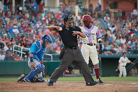 Umpire Luis Hernandez throws a ball to the pitcher as Frisco RoughRiders Michael De Leon (1) bats during a Texas League game against the Amarillo Sod Poodles on July 13, 2019 at Dr Pepper Ballpark in Frisco, Texas.  Catching is Luis Torrens.  (Mike Augustin/Four Seam Images)
