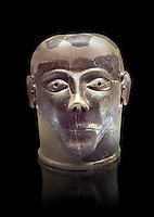 6th century B.C clay head made in Chiusi, inv 94619, National Archaeological Museum Florence, Italy , black background