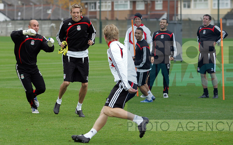 Liverpool Champions League Training, Melwood Training Complex, West Derby, Liverpool, 5th November 2007...Peter Crouch (C) is chased by Pepe Reina (L) as he chases Dirk Kuyt.