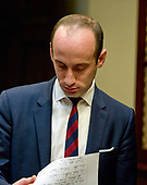 Stephen Miller, Senior Advisor for Policy looks over his notes prior to the arrival of United States President Donald J. Trump for a listening session with the Fraternal Order of Police in the Roosevelt Room of the White House in Washington, DC on Tuesday, March 28, 2017.<br /> Credit: Ron Sachs / Pool via CNP
