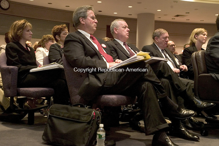 HARTFORD, CT. 29 August 2008-082908SV08--From left, Dr. Henry Borrows, medical director of the heart center, and John Tobin, President and CEO of Waterbury Hospital, listen to public comment about extending the Heart Center of Greater Waterbury's three-year operating permit an additional six months during a public hearing of the Office of Health Care Access at the Legislative Office Building in Hartford Friday.<br /> Steven Valenti Republican-American