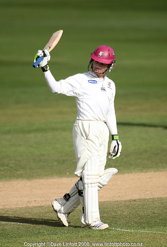 James Marshall acknowledges applause for his century during the State Championship cricket match between the Wellington Firebirds and Northern Knights at Allied Prime Basin Reserve, Wellington, New Zealand on Thursday, 4 December 2008. Photo: Dave Lintott / lintottphoto.co.nz