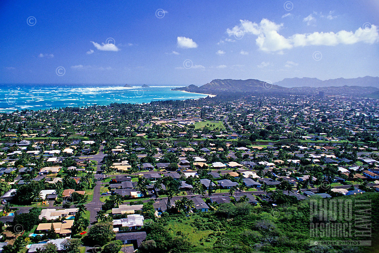Great aerial shot of residential Kailua on the windward side of Oahu. Shot from Kaneohe, the view spans out to Lanikai and the Mokuluas.