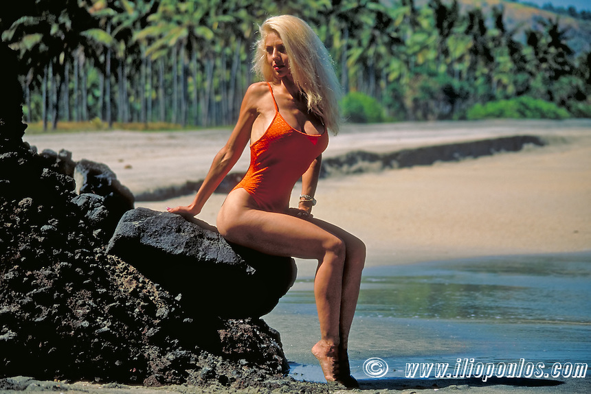 Beautiful young blond woman on the beach