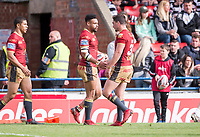 Picture by Allan McKenzie/SWpix.com - 22/04/2018 - Rugby League - Ladbrokes Challenge Cup - York City Knight v Catalans Dragons - Bootham Crescent, York, England - Catalans Jodie Broughton is congratulated on scoring a try against York.