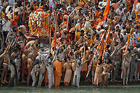 Naga Sadhus (naked saints) at the time of  holy dip during the first Sahi Snan (Royal dip) at Kumbh mela on 12th February 2010. Haridwar, Uttara Khand, India, Arindam Mukherjee