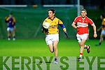 Denis Walsh (Feale Rangers) in action with Adrian Devane (Dingle) in The Garveys SuperValu Senior County Championship at Austin Stack park, Tralee on Saturday night.