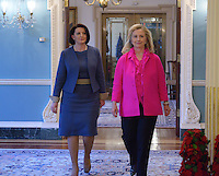 December 14, 2011  (Washington, DC)  U.S. Secretary of State Hillary Clinton and the President of Kosovo, Atifete Jahjaga (left), enter the Treaty Room at the Department of State to sign an agreement to preserve cultural heritage sites in Kosovo.    (Photo by Don Baxter/Media Images International)
